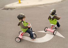Follow Directions!. A young boy riding his tricycle following directions just like daddy said Stock Photos