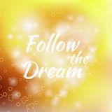 Follow the Dream lettering on unfocused colorful Stock Photos