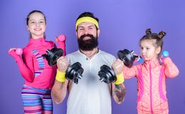 Follow father. Girls cute kids exercising with dumbbells with dad. Motivation and sport example concept. Children repeat. Exercise after dad. Sport exercise for stock photos