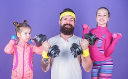 Follow father. Girls cute kids exercising with dumbbells with dad. Motivation and sport example concept. Children repeat royalty free stock photography