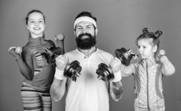 Follow father. Girls cute kids exercising with dumbbells with dad. Motivation and sport example concept. Children repeat. Exercise after dad. Sport exercise for stock image