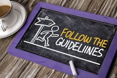 Follow the guidelines handwritten on blackboard Stock Photos