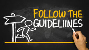 Follow the guidelines handwritten on blackboard Royalty Free Stock Photography