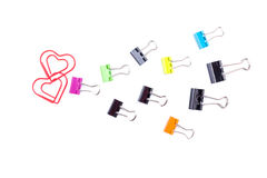 Follow the heart made by multicolored paper clip binders isolate Stock Images