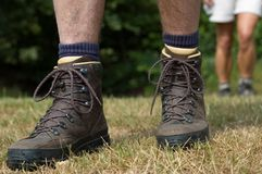 Follow the hiker. Woman following the hiker. Hiking boots in front stock photo
