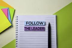 Follow the Leader text on top view office desk table of Business workplace and business objects stock images
