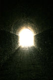 Follow the light. Unused train tunnel on a mountain biking trail stock photos