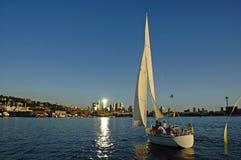Follow the Light. Sailboat sailing towards downtown Seattle, WA Stock Photography