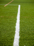 Follow the line. Detail of one of the lines that define areas within on a football field Royalty Free Stock Photo