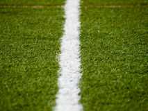 Follow the line. Detail of one of the lines that define areas within on a football field Royalty Free Stock Photos