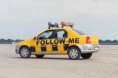 Follow Me airport car. An airport services Follow Me car, painted in yellow and black checkered pattern royalty free stock image