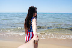 Follow me in the American flag swimsuit Stock Photography
