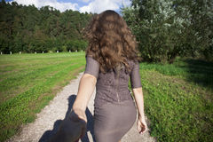 Follow me, Beautiful young woman holds the hand of a man Stock Photo