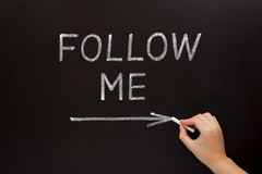 Follow Me Blackboard Concept Stock Image