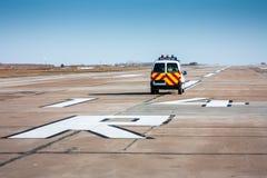 Follow me car at the runway. Follow me car at the airport runway Stock Photo