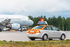 Follow me car meets an airplane to indicate the location for the arrival of an aircraft. Follow me car meets an airplane to indicate the location for the stock photo