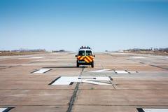 Follow me car at the runway. Follow me car at the airport runway Royalty Free Stock Images