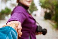 Follow me Concept Woman pulling Man Hand toward street Royalty Free Stock Images