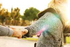 Follow me - girl pulling hand of a man Stock Image