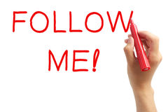Follow me!. Hand with red marker writing 'Follow me!'. On white background Stock Photo