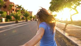 Follow me - happy young woman pulling guy`s hand - hand in hand running on a bright sunny day. Slow motion stock footage