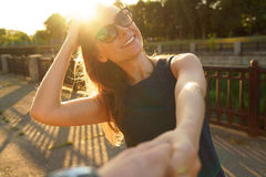 Follow me - happy young woman pulling guy`s hand - hand in hand Royalty Free Stock Image