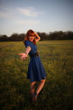 Follow me. Red-haired girl invites to follow her royalty free stock photo