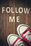 Follow Me request on wood.  Stock Photography