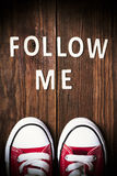 Follow Me request on wood.  Royalty Free Stock Photography