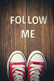 Follow Me request on wood.  Royalty Free Stock Images