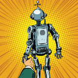 Follow me, the robot leads us forward. Pop art retro vector. Artificial intelligence civilization, technological revolution. Autopilot Royalty Free Stock Photo