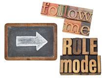 Follow me and role model. Leadership concept - collage of isolated text in vintage letterpress wood type and white chalk arrow on a slate blackboard royalty free stock image