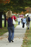 Follow me to Class. Female student with backpack walking to class (seen from behind Stock Photography