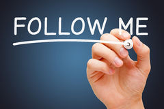 Follow Me White Marker. Hand writing Follow Me with white marker on transparent wipe board stock photography