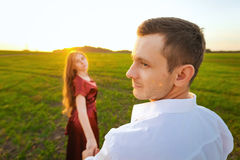 Follow me, woman leads man by the hand Royalty Free Stock Images