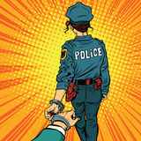 Follow me, a woman police officer is arrested by the hand Stock Image
