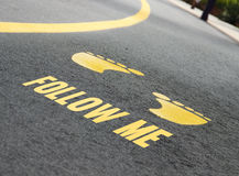Follow me written on the road Royalty Free Stock Image