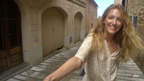 Young Woman Leading a Man to the Adventure in an Old European Town. Follow me. Young Woman Leading a Man to the Adventure in an Old European Town stock video footage