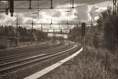 Follow a railroad track. And havey clouds stock photography