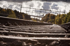 Follow a railroad track. And havey clouds stock photos