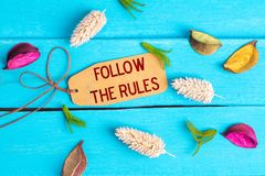 Follow the rules text on paper tag royalty free stock images