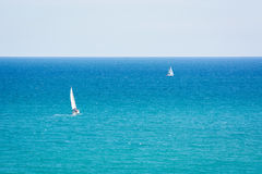 Follow that ship. A couple of yachts sailing by sea on a clear day Stock Photos