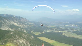 Follow shot of a paraglider launching into flight stock video