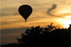 Follow sun. Balloon, sunset, clouds, rays of sun Royalty Free Stock Photos