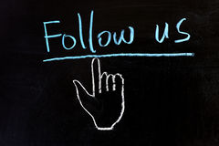Follow us. Chalk drawing - Follow us and hand pointer royalty free stock images