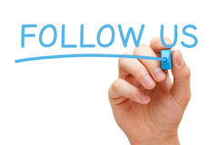 Follow Us Concept. Hand writing Follow Us with blue marker on transparent wipe board Royalty Free Stock Photography