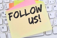 Follow us follower followers fans likes social networking media. Internet business concept note paper computer keyboard Stock Photos