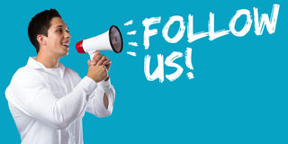 Follow us follower followers fans likes social networking media. Internet young man megaphone bullhorn Stock Photos