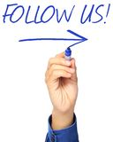Follow Us. A hand writing Follow Us on a whiteboard Stock Image