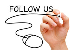 Follow Us Mouse. Hand sketching Follow Us concept with black marker on transparent wipe board royalty free stock photo